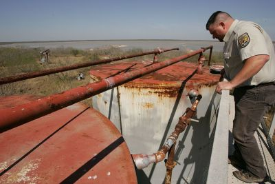 Cleaning up abandoned fossil fuel infrastructure could provide local jobs for displaced workers. Steve Hillebrand/US Fish and Wildlife Service.