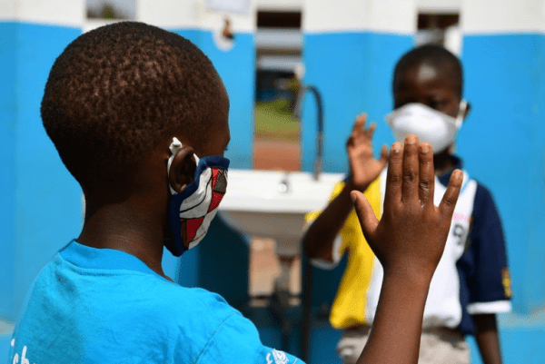 Kolo Magloire, a 10-year-old boy and young reporter, with his 6-year-old friend Chris Alex in Korhogo, in the North of Côte d'Ivoire. The young boys are wearing both a mask to protect themselves against the coronavirus. They also wash their hands regularly. Kolo wants to become a footballer and his friend a teacher. For every child, a corona free life. Featured Photo Credit: © UNICEF/UNI325661// Frank Dejongh
