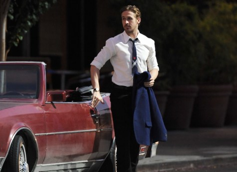 """Acotr Ryan Gosling puts on a serious face while getting last minute instructions on the set of """"La La Land"""" filming in Pasadena while co star Emma Stone goofs around with the film crew. Featuring: Ryan Gosling Where: Pasadena, California, United States When: 18 Aug 2015 Credit: Cousart/JFXimages/WENN.com"""