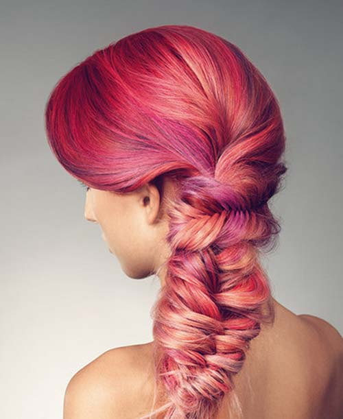 Braided hairstyle with different colors of red chalk strands