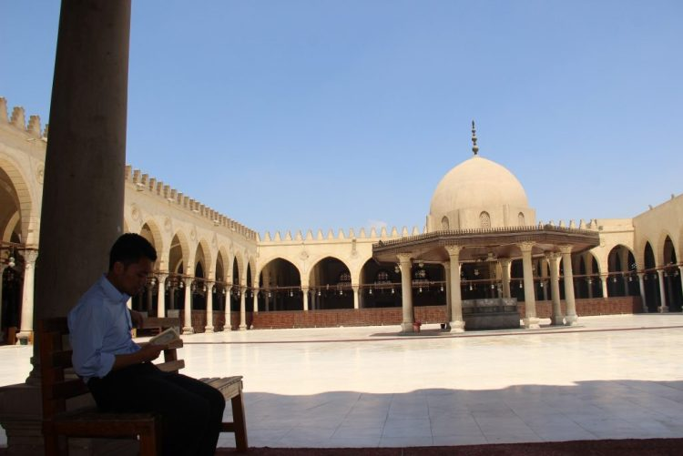 reading a quran in the chair of Masjid Amr ibn al-As, Cairo