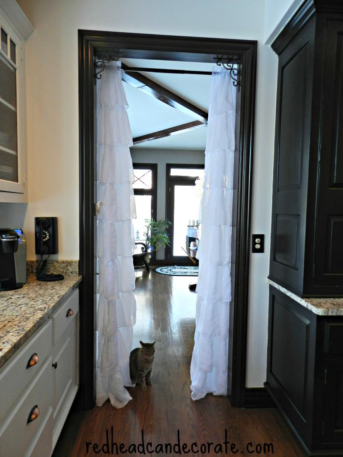Hang curtains in your doorway.