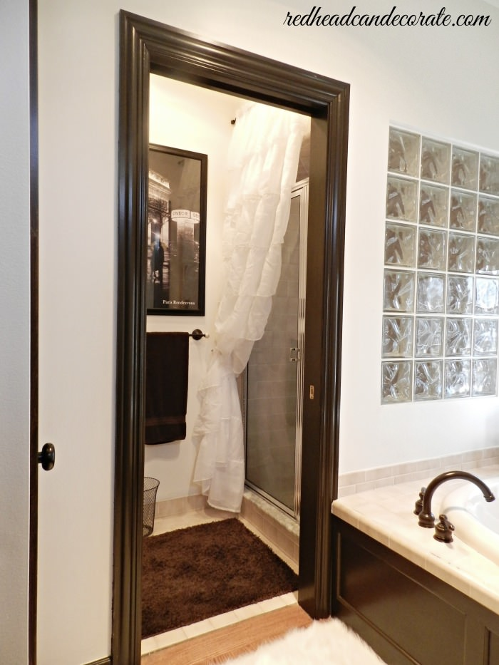 Ruffled Curtain Over Glass Shower Door by Redheadcandecorate.com