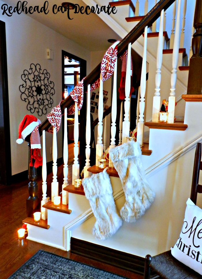 Wrap a scarf around the base of your bannister & add a Santa hat for a cozy Christmas idea...