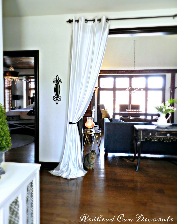 Never thought of this before! Grommet curtain panels hung in the entry way make a dramatic statement.