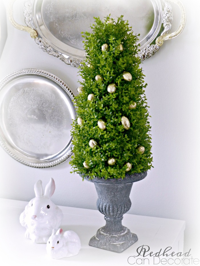 How cute & easy is this Easter Egg Boxwood Topiary! She used dollar store eggs and the topiaries are pretty affordable and can be used for many seasons and occasions.
