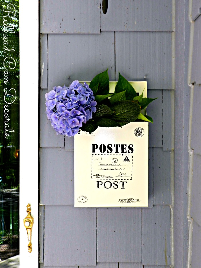 What a cute vintage style mailbox to hang by your door even if you don't need one there. She fills hers with flowers!