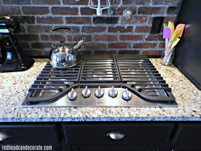 This Mom finally got tired of cleaning her ceramic cooktop and installed one of these babies! It's a stainless steel gas cooktop that is super easy to clean! Bravo, Mom!