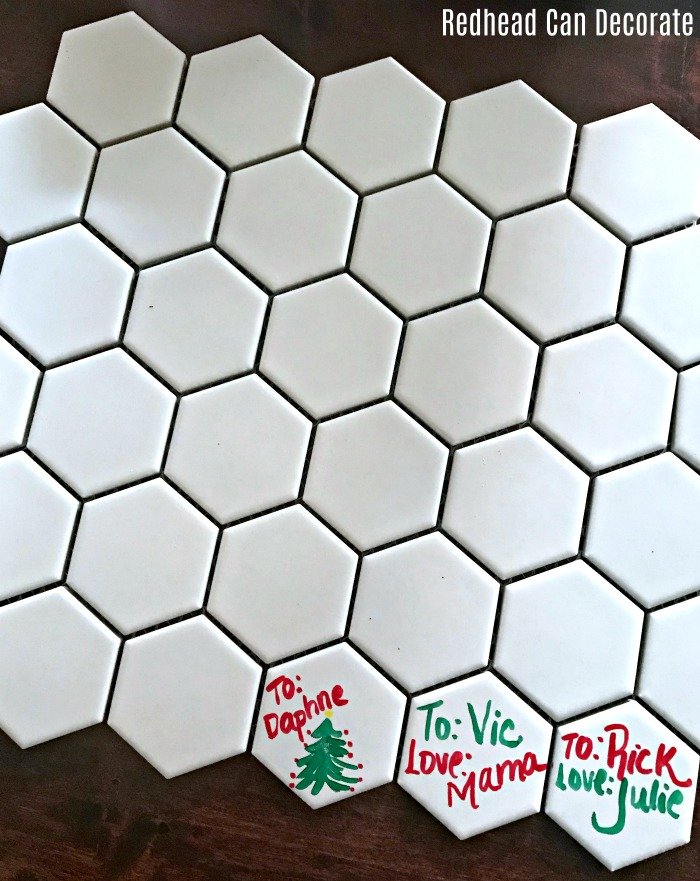 These clever Reusable Christmas Gift Tags are made from ceramic tiles and can be used over and over saving lots of time and money!