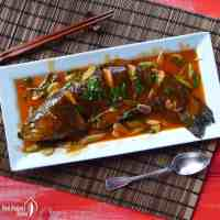 a whole fish cooked with sweet & sour sauce