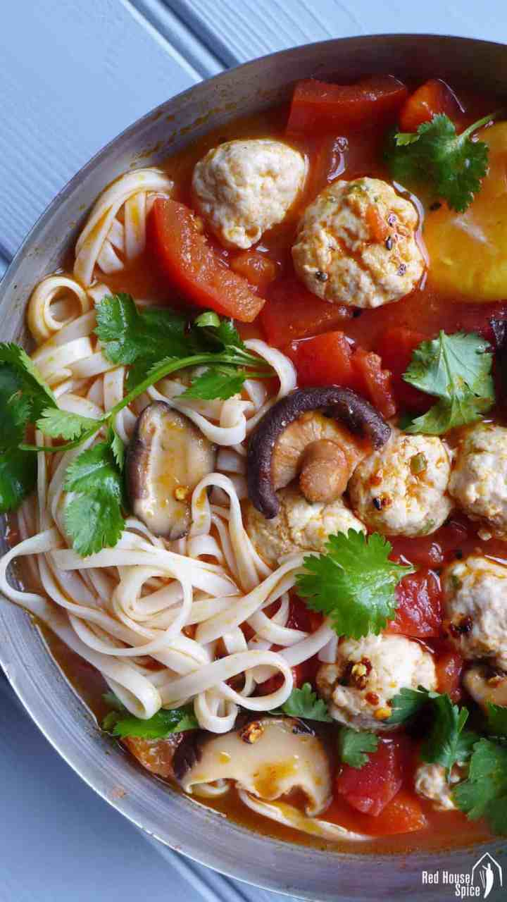 Tender and springy meatballs cooked in tomato and shiitake soup. This chicken meatball noodle soup is super tasty, filling and healthy.