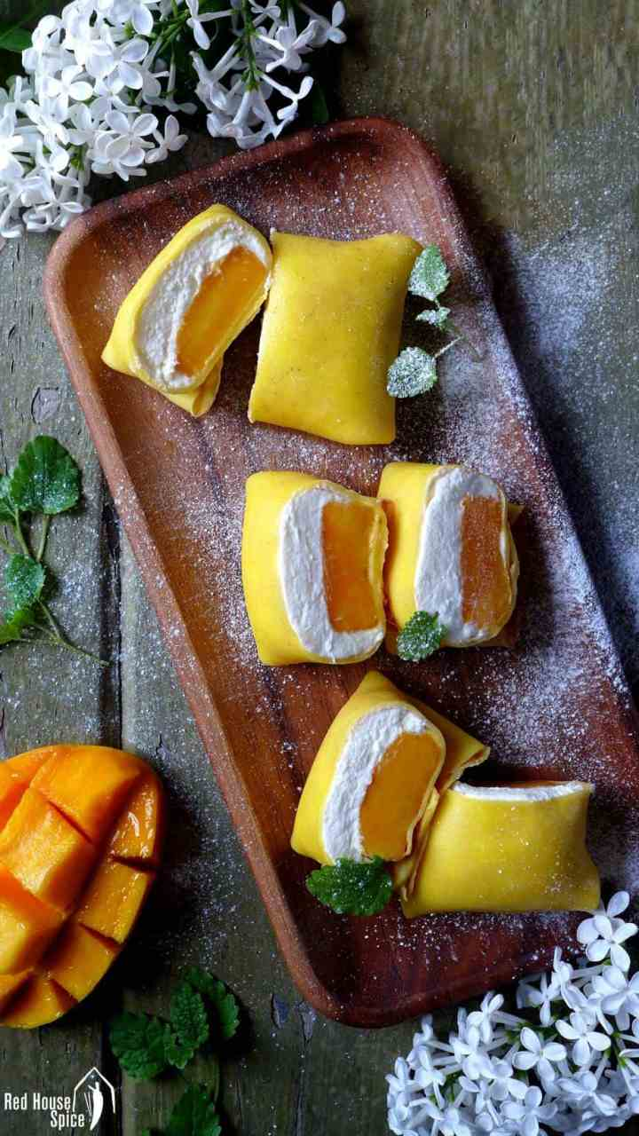Fresh mango chunks topped with fluffy whipped cream, then wrapped with thin, moist and elastic crepes, these pillow-shaped mango pancakes are to die for.