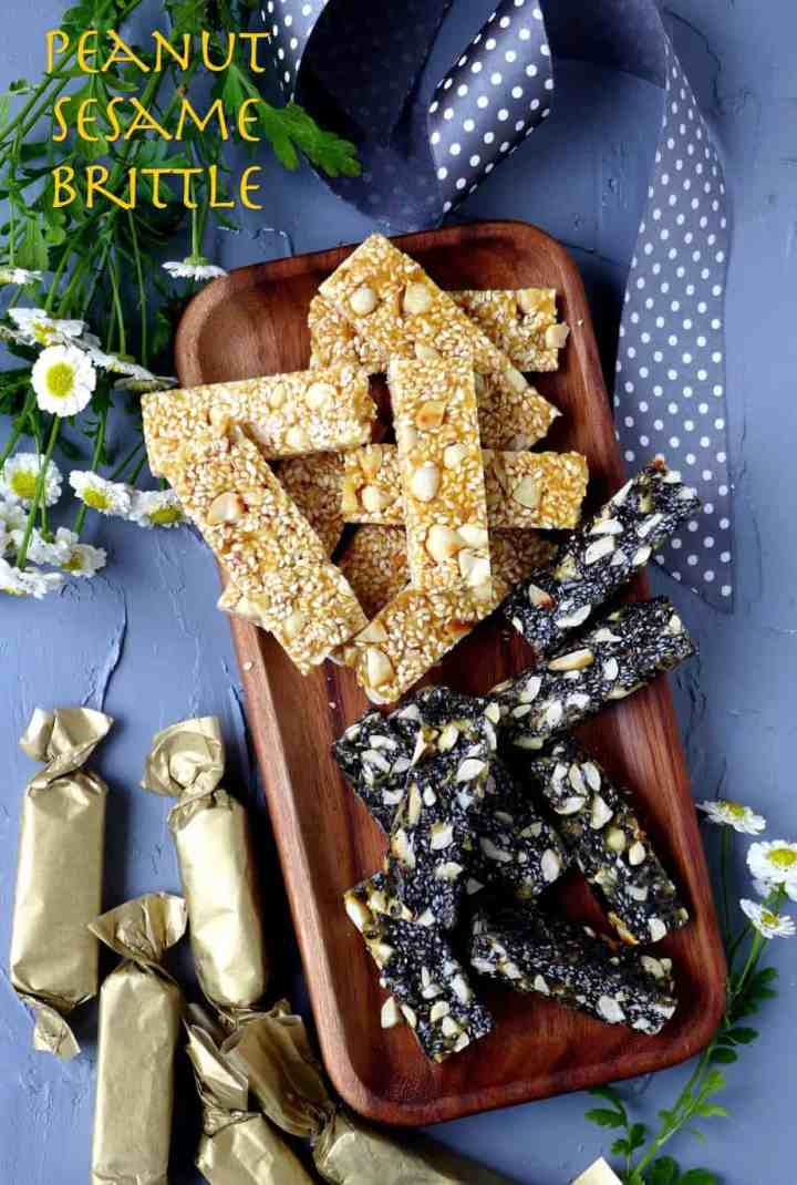 Brittles on a plate. Some are made of peanuts and white sesame seeds. Others made of peanuts and black sesame seeds.