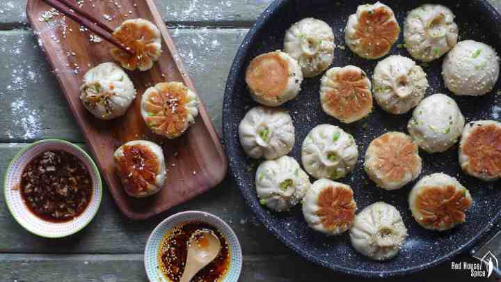 Sheng Jian Bao (pan-fried pork buns) in a plate and in a frying pan.