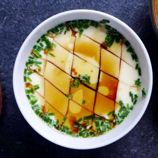 You only need soy sauce and sesame oil to season Chinese steamed eggs.
