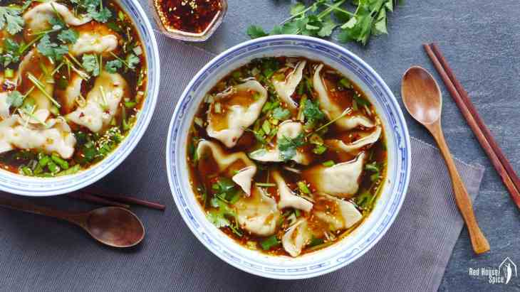 Beef dumplings in a bowl of hot & sour soup. Looks very appetizing.