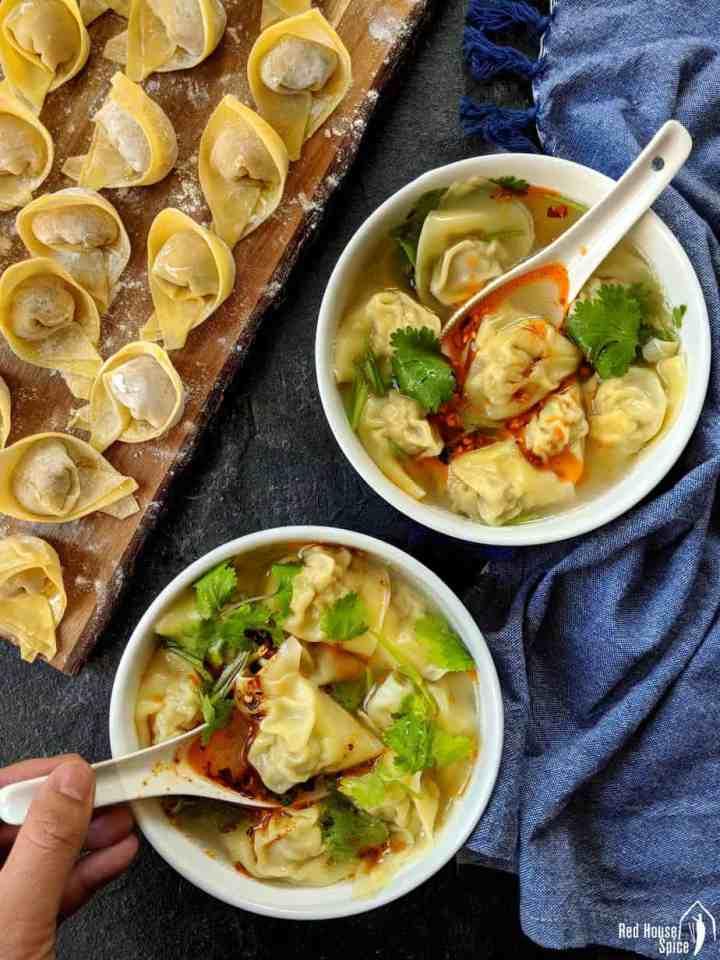 Two bowls of pork wonton soup