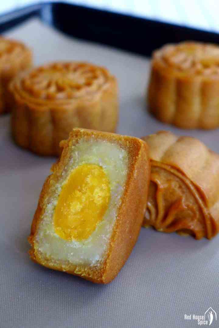 A halved mooncake showing the salted egg yolk filling