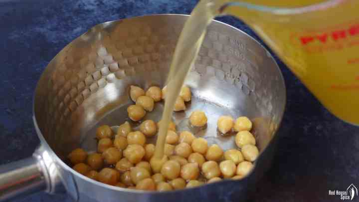 Chicken stock poured over some chickpeas.