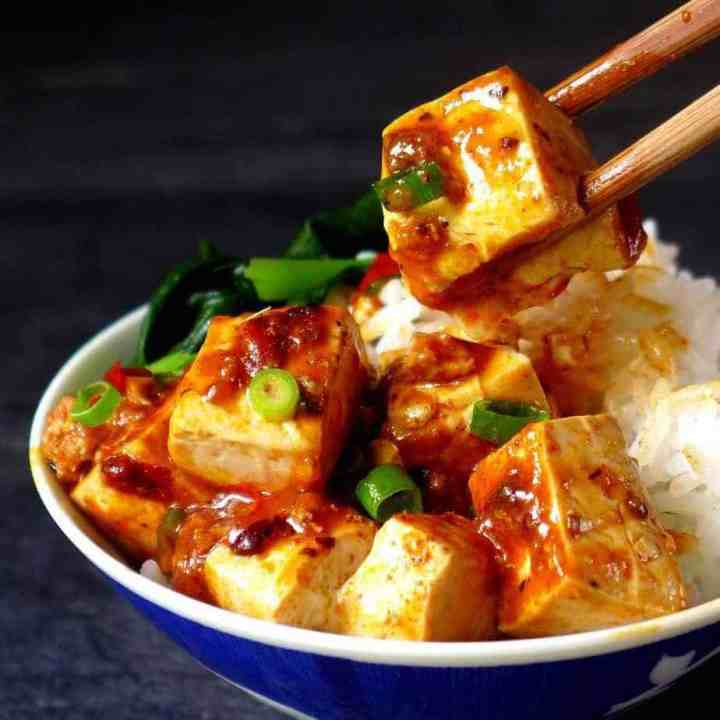 Mapo tofu over a bowl of rice