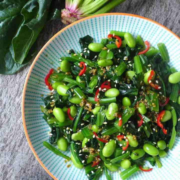 A plate of spinach and edamame salad