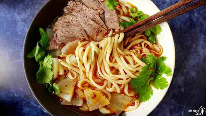 A bowl of hand-pulled noodles with in broth