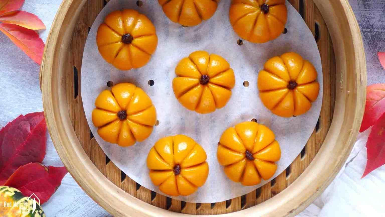 pumpkin shaped cakes in a steamer.