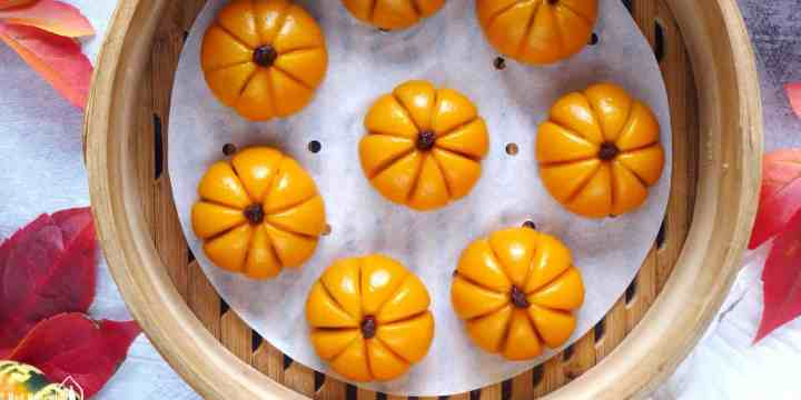 pumpkin shaped mochi cakes in a steamer.