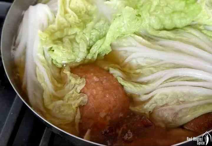 Napa cabbage over meatballs