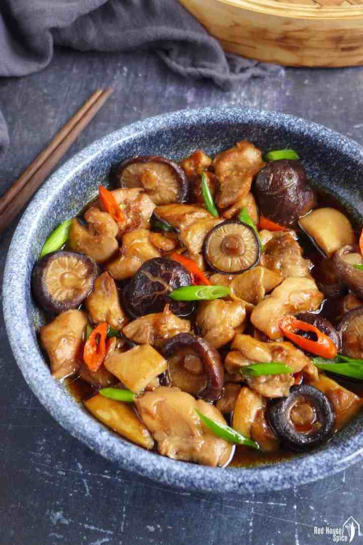 A plate of Chinese steamed chicken with shiitake mushroom