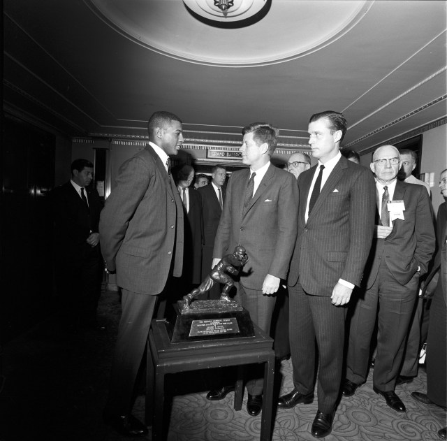 ST-274-1-61 5 December 1961 President Kennedy meets Heisman Trophy winner Ernest Davis at the Waldorf Astoria, New York City. The President was attending the National Foundation (Football) Hall of Fame Dinner. Photograph by Cecil Stoughton, in the John F. Kennedy Presidential Library and Museum, Boston.