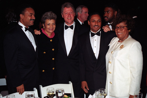 Photograph of President William J. Clinton Posing with Members of His Administration at the Congressional Black Caucus Dinner (NAID 3598926)