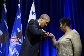 President Barack Obama greets Aretha Franklin as she is introduced to perform during the portrait unveiling ceremony for Attorney General Eric H. Holder, Jr. at the U.S. Department of Justice in Washington, D.C., Feb. 27, 2015. (Official White House Photo by Pete Souza)