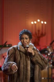 """P030614DL-0453: Aretha Franklin performs during the """"Women of Soul"""" In Performance at the White House"""" in the East Room, March 6, 2014. Courtesy Barack Obama Presidential Library."""
