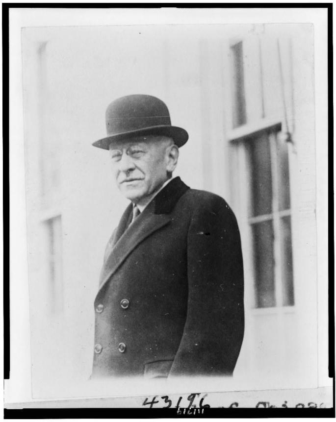 Julius Rosenwald of Chicago, President of Sears, Roebuck and Co., half-length portrait, standing outside the White House, facing left