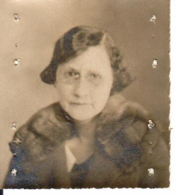 3/4 portrait, Finch is wearing glasses and a coat with fur collar