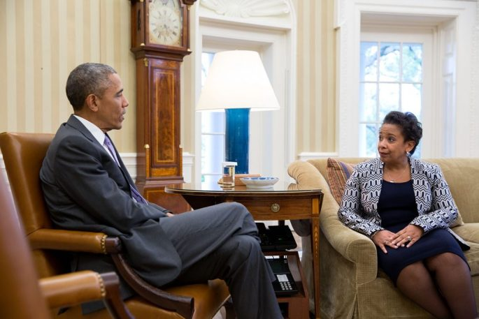 Lynch and Obama in conversation while sitting in two different chairs