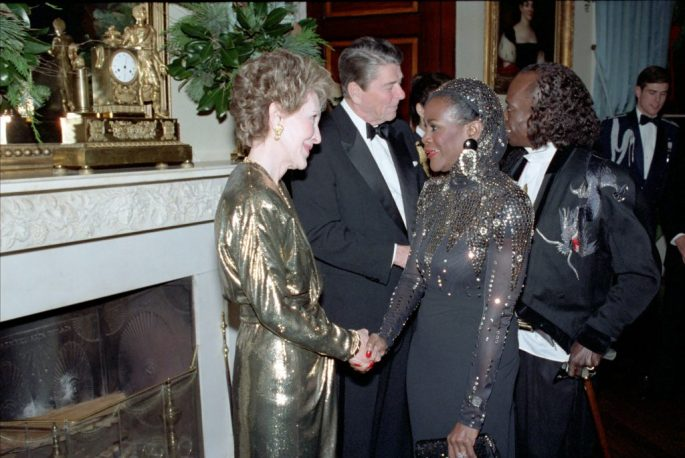 Cicely Tyson and Miles Davis in a receiving line shaking hands with Nancy Reagan