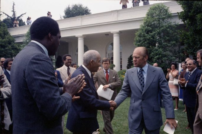 Rose Garden – The White House – Washington, DC – Gerald R. Ford, Roy Wilkins, Vernon Jordan – greeting, handshaking – Prior to Signing Ceremony for H.R. 6219, Extending the Voting Rights Act of 1965