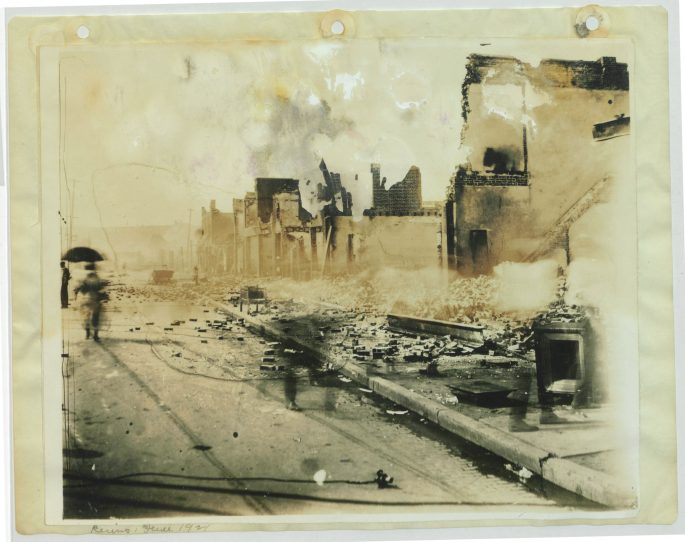 view of a street w/burned out/destroyed buildings