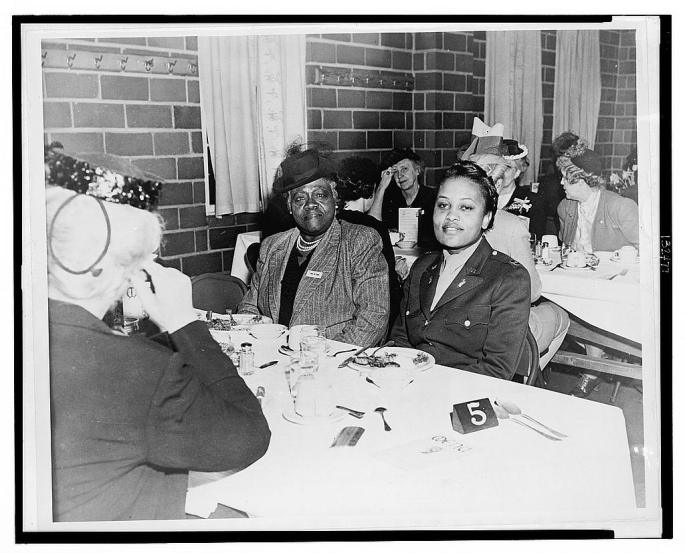 Johnson and Mary McLeod Bethune seated at a table