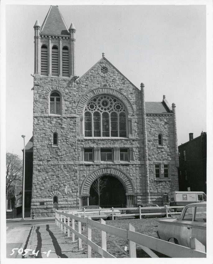 facade of Churh showing bell tower and entrance