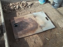 Cover with 1/4 sheet metal- hinges and chimney hole
