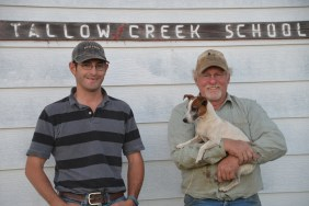 Leo, his sidekick Clancy, and his son Eric Barthelmes at the Tallow Creek School. They both attended the Tallow Creek School down the road from their ranch where they run cattle and sheep.