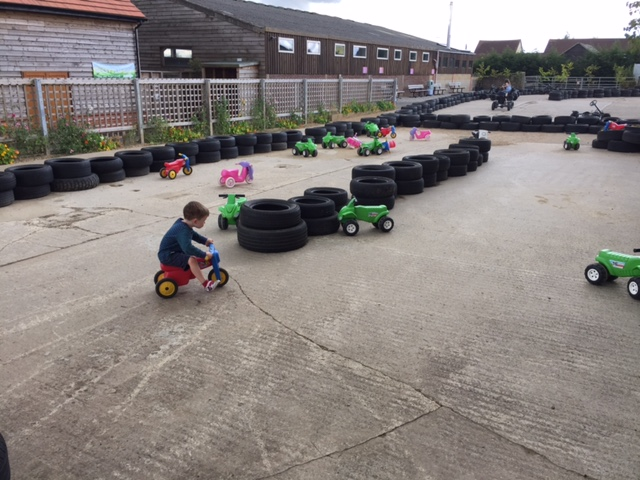 green dragon, kids, race track, pedal cars