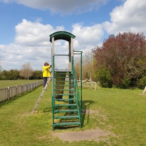 boy climbing slide steps in playground in Weston turville bucks