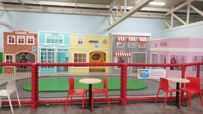 role play village for toddlers at djs soft play in hemel with seating area