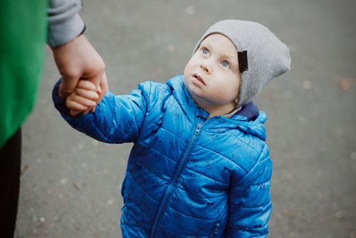child holding mums hand to go to nursery