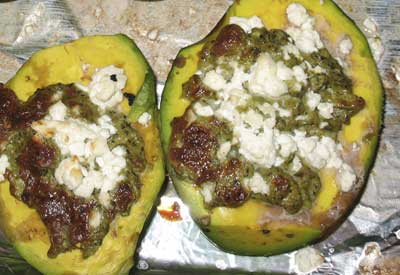 Broiled avocados stuffed with scrambled eggs and goat cheese