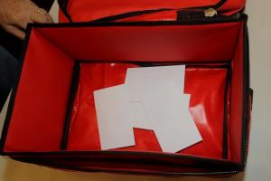 For each contest the names are put into envelopes which are then placed in the red ballot box